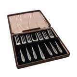 Six early 20th century, silver pastry forks & server & fitted case