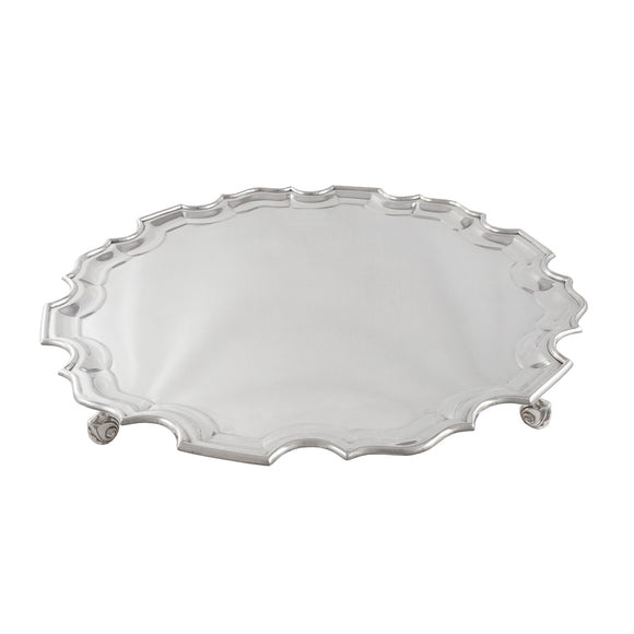 An Edwardian, silver, circular salver on four feet