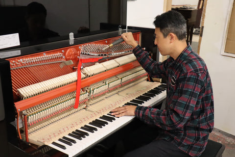 Marco Tuning a Black High Gloss Upright Piano