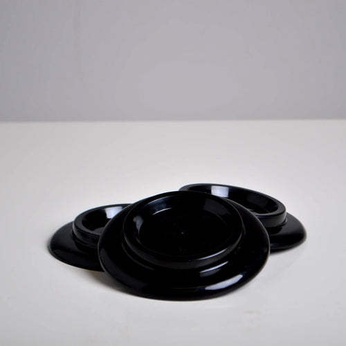 Black Plastic Castor Cups design