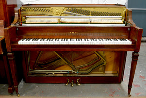 Yamaha M217 upright piano in American walnut finish