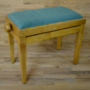 Oak matt and green velvet piano stool