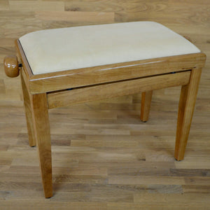 Polished maple and beige velvet piano stool