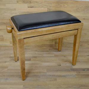 Polished maple and black leather piano stool