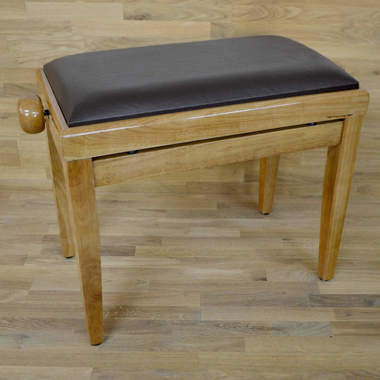 Polished maple and brown leather piano stool