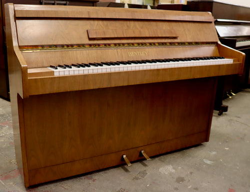 Bentley Upright piano in burl walnut cabinet