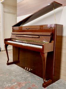 Schimmel 116 Upright piano in mahogany with cabriolet legs
