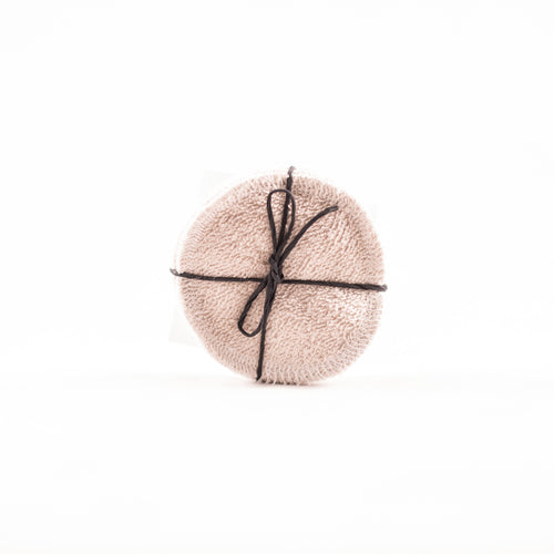 Cotton makeup remover pads, sand