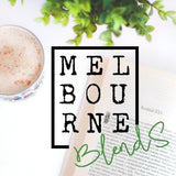 Cup of Freshly made chai latte on table with open book in background with lovely company Melbourne blends company logo
