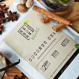 Coconut Chai Latte packed in 200gr white bag with cream label position on timber board Keto approved, 100% Vegan, less than 2 grams of sugar per serve