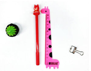 Red Batman Themed Colored Ball Pen Placed Beside Pink Giraffe