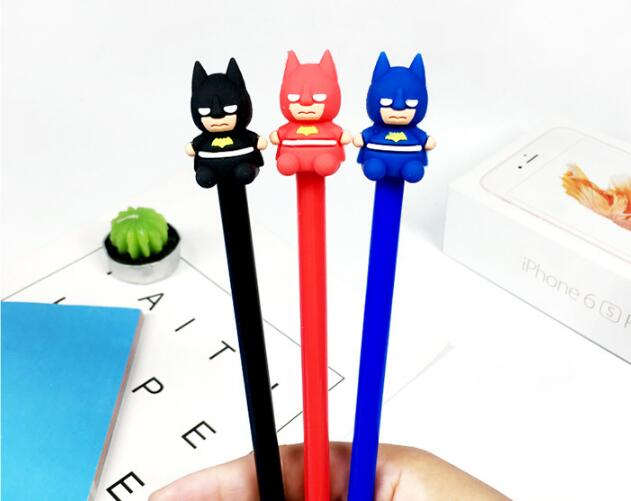 Hand Holding Three Batman Themed Colored Ball Pen