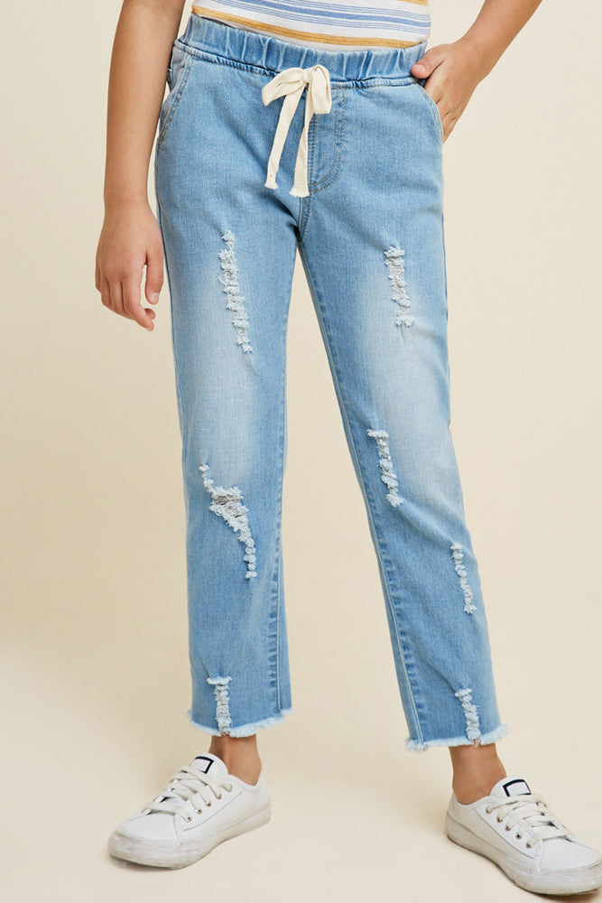 Teens light wash distressed denim jeans.