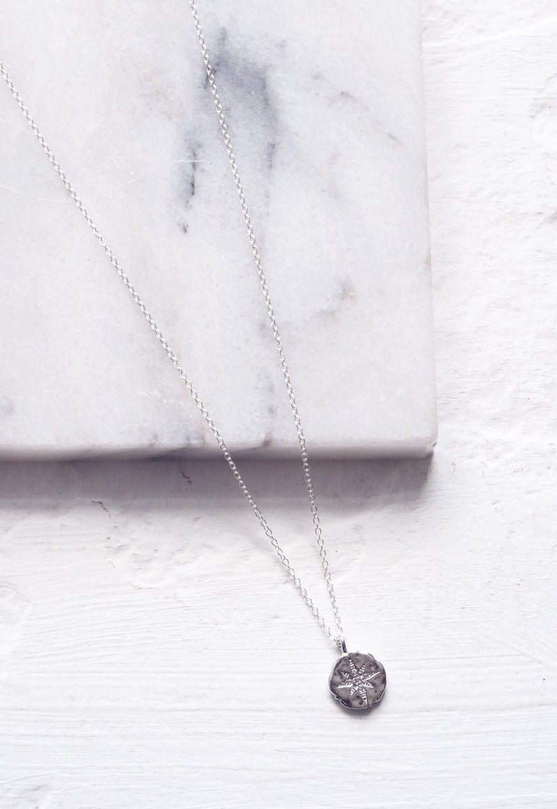NORI. Silver North Star Coin Pendant Necklace