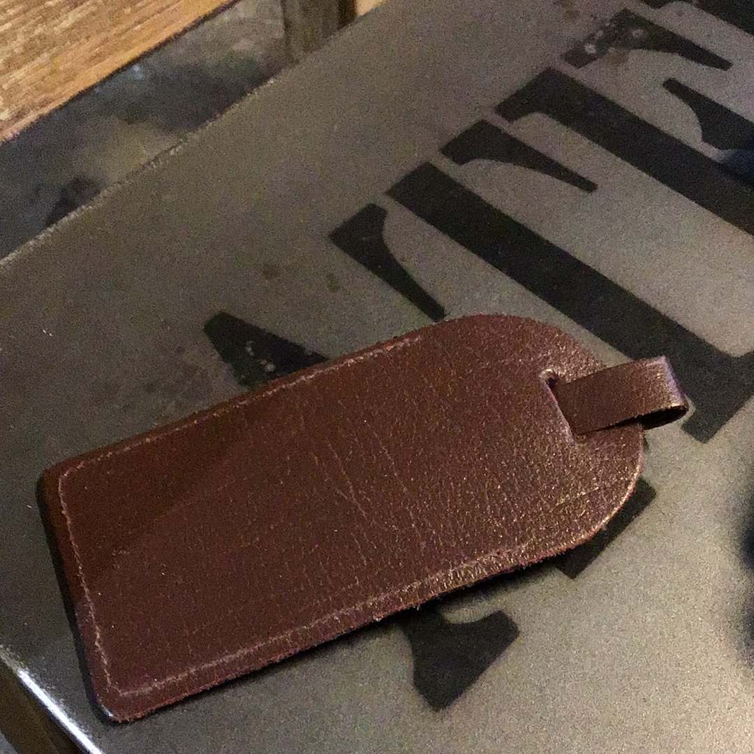 Small brown luggage tag