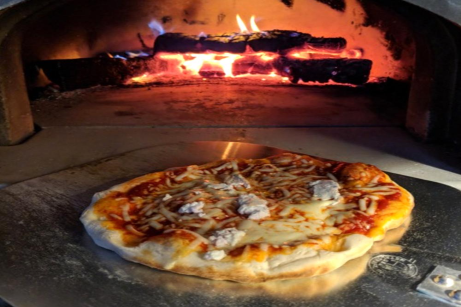 Pizza with flames in CBO Pizza Oven