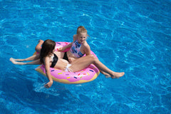 girls floatin in pool-essential guide to pool cleaning