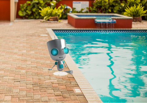 pool cleaning guide-robot stting at pool