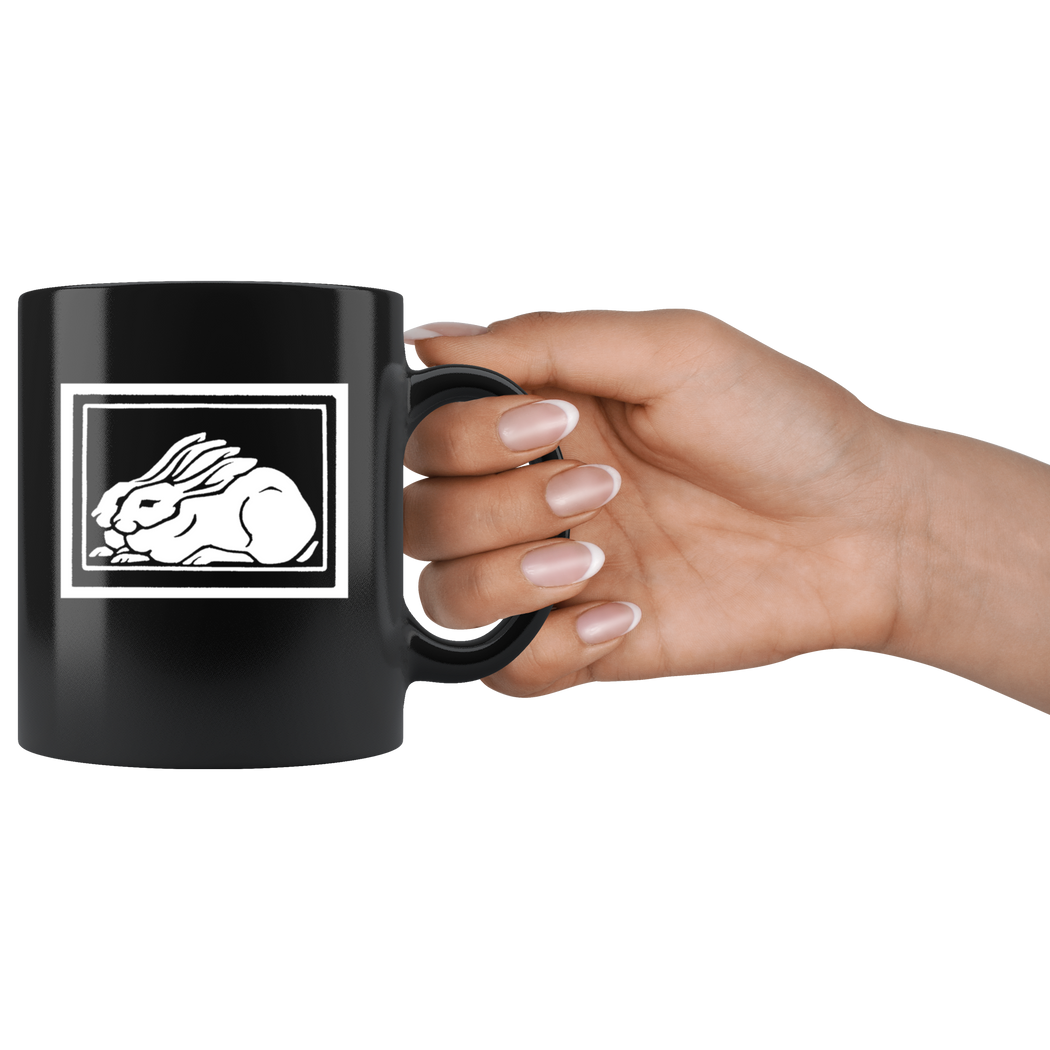 Rabbits woodcut coffee mug -- by Julie de Graag