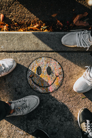 Drawing of smiley face on the street