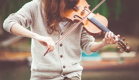 Girl practice playing violin