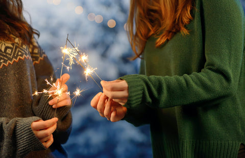Holding New Year sparklers