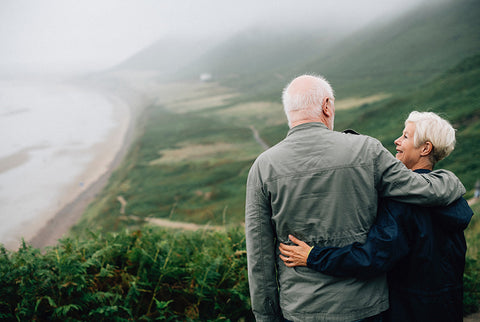 mature couple enjoying clean air and views of the ocean