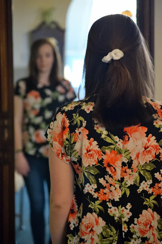 Woman checking herself in the mirror