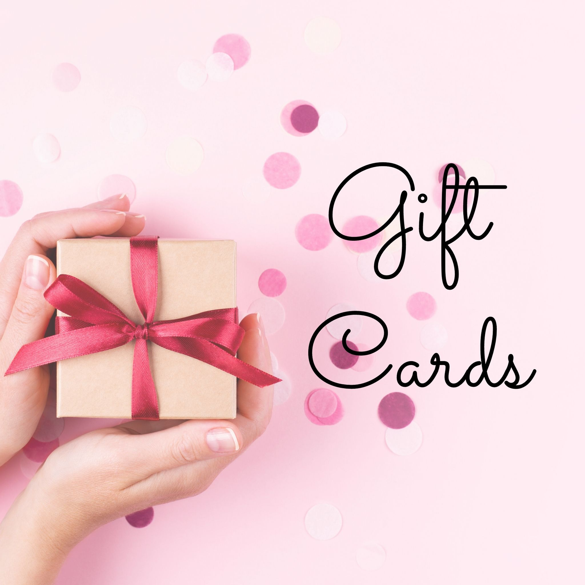 A woman's hands hold a gift wrapped box tied with red ribbon, on a pink background with confetti; the words Gift Cards sits to the right