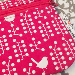 Pink zipper pouch with little birds and fire sparks creations label