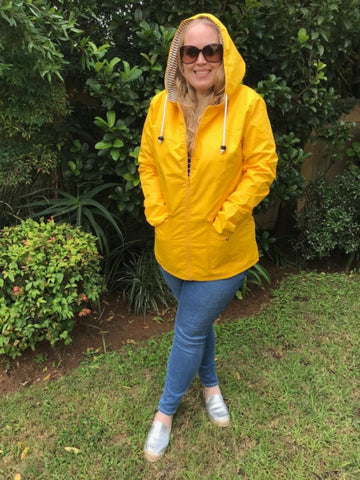 yellow raincoat silver lining gumboots front view
