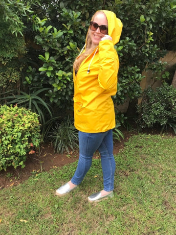 yellow raincoat silver lining gumboots side view