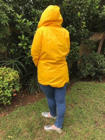yellow raincoat silver lining gumboots back view