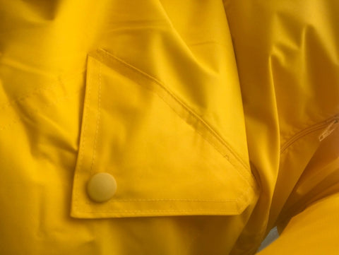 silver lining gumboots yellow raincoat pocket detail