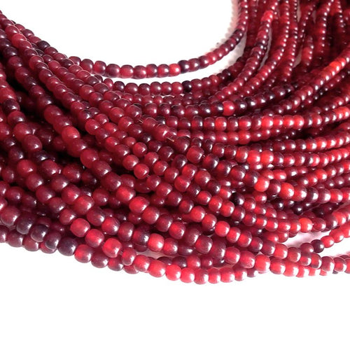 Perles rouges en corne naturelle 4-5mm