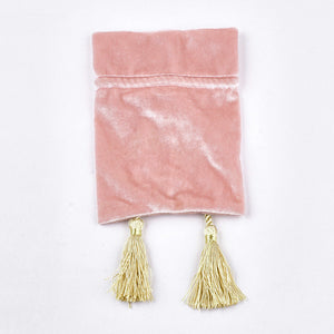 Pink velvet pouch bag with tassel rope