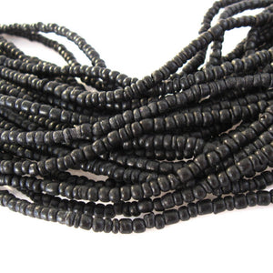 Tiny black coconut beads 2-3mm