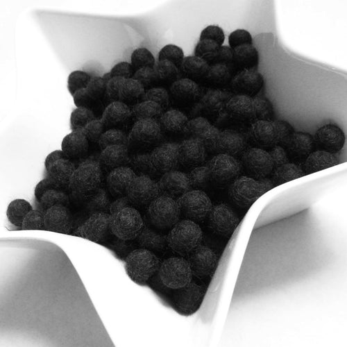 1cm felt balls - 25 black pure wool beads