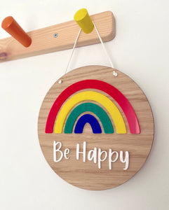 colourful rainbow plaque with Be Happy on