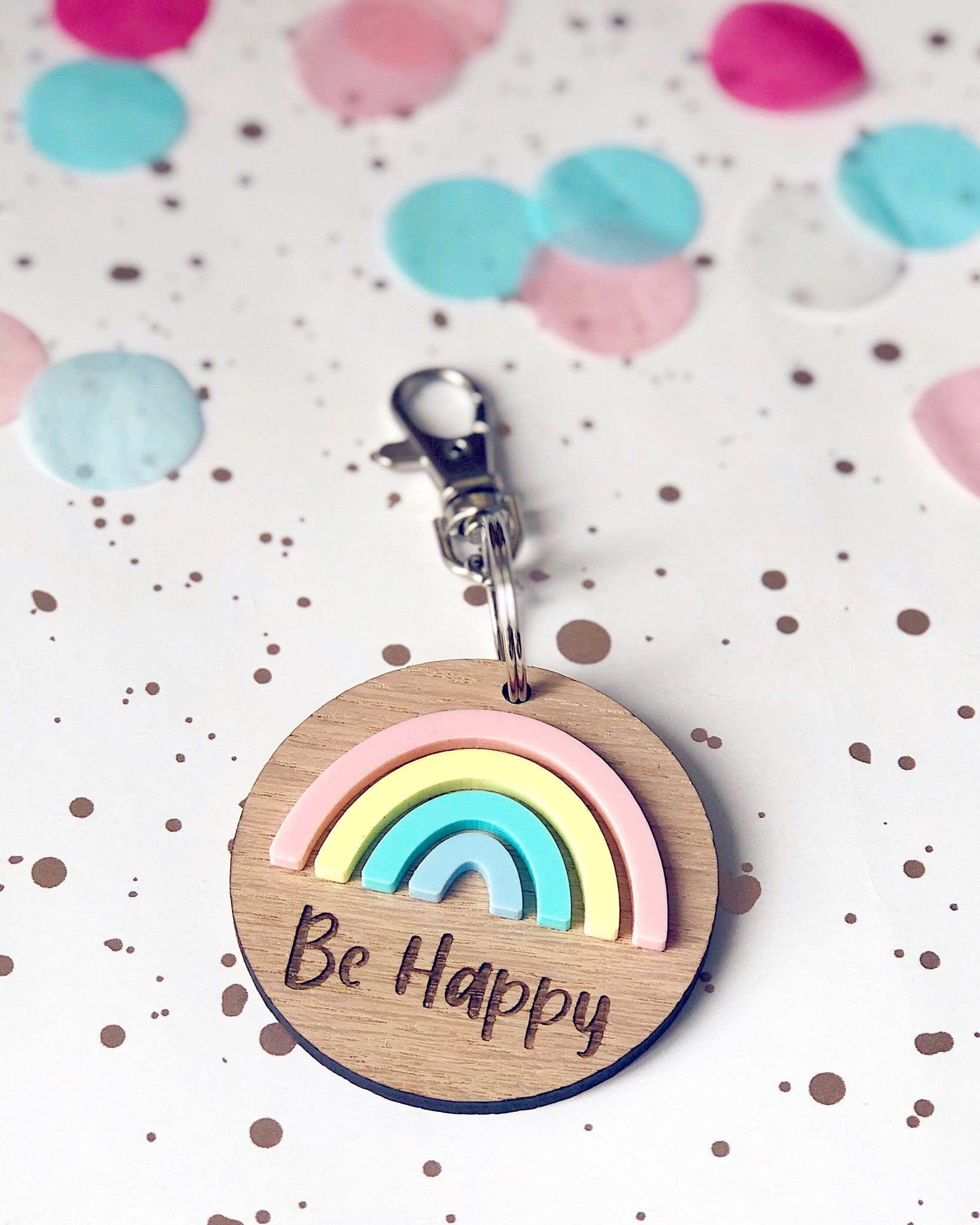 Be Happy Rainbow key ring - pastel coloured rainbow in acrylic with wooden cirrcular keyring