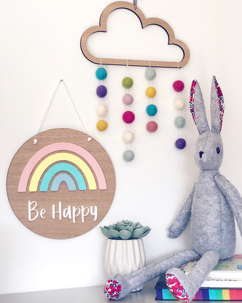 Wooden rainbow plaque with pom pom cloud and bunny soft toy