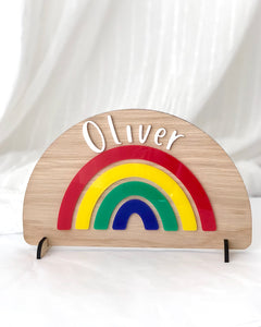 personalised wooden and acrylic colourful rainbow. Freestanding with child's name