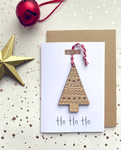 Christmas card with a wooden christmas tree decoration on the front
