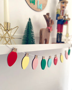 Multicoloured christmas lights hanging from a shelf