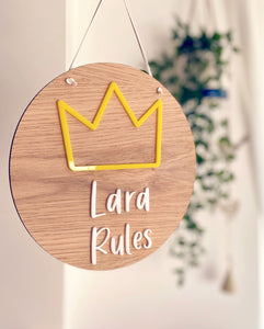 Circular wooden children's plaque with yellow crown and Lara Rules