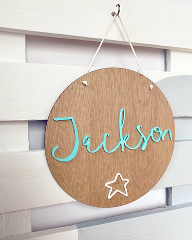 Wooden plaque with pastel mint green name and a white star
