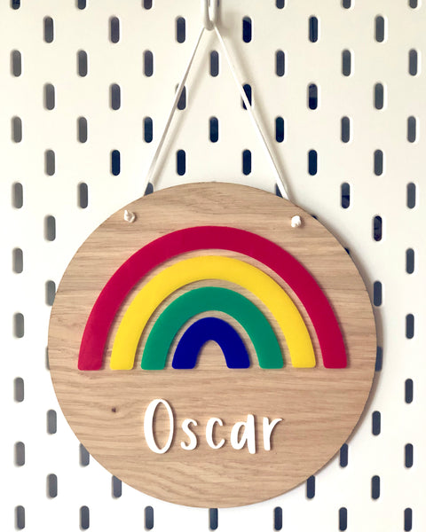 personalised wooden plaque with colourful acrylic rainbow and name