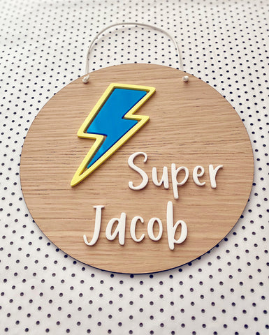 wooden superhero plaque with blue and yellow lightning bold and child's name