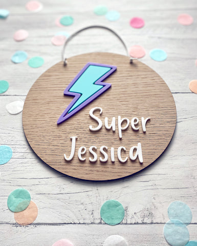 Wooden plaque with pastel lilac and mint green lightning bolt. Personalised with child's name