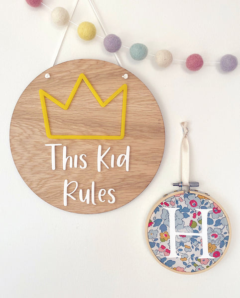 This Kid Rules wooden plaque with yellow crown